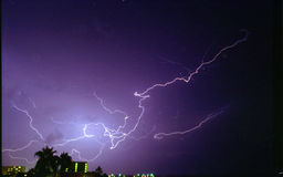 Purple Lightning. Bright Overhead Cloud-to-Cloud Lightning in Tampa stock images