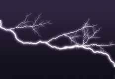 Purple lightning branched out in the sky Stock Photo
