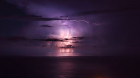 Purple lightning over the sea Stock Images