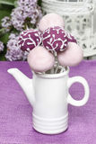 Purple and lilac cake pops in white ceramic jug. Birthday party Royalty Free Stock Photo