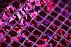Purple lilac glitter square sequin glitter fabric background Stock Photo
