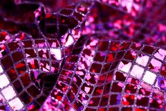 Purple lilac glitter square sequin glitter fabric background Royalty Free Stock Image