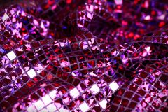 Purple lilac glitter square sequin glitter fabric background Stock Photos