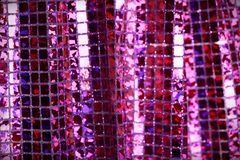 Purple lilac glitter square sequin glitter fabric background Stock Photo