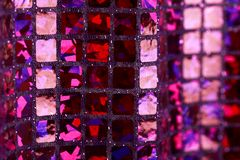 Purple lilac glitter square sequin glitter fabric background Royalty Free Stock Images