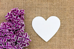 Purple lilac and a heart. As a background Stock Photography