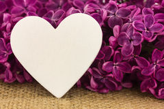 Purple lilac and a heart. As a background Stock Photo