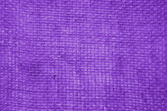 Purple linen fabric background Stock Photos
