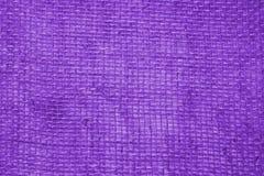Purple linen fabric background stock photos