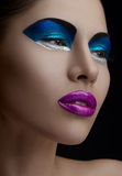 Purple lips, blue shadows on the eyes, black eyebrows Women Makeup Beauty. Studio Stock Photo