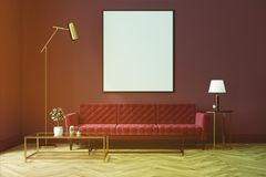 Purple living room, red sofa, poster toned. White living room interior with a wooden floor, loft windows, a red sofa, a coffee table and a framed vertical poster Stock Photography