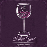 Purple love card with a glass of wine filled with hearts Stock Photo