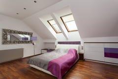 Purple luxurious bedroom Stock Photos