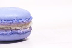 Purple macaroon sideview closeup Royalty Free Stock Photo