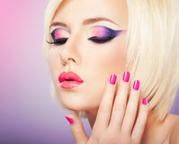 Purple makeup. Beautiful woman with bright violet purple makeup, lips and manicure royalty free stock image