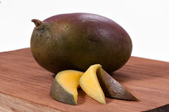 A purple mango. Mango on a white background Royalty Free Stock Photography