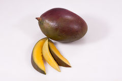 A purple mango. Mango on a white background Royalty Free Stock Image