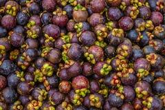 Purple mangosteens on a market, Philippines Stock Photo