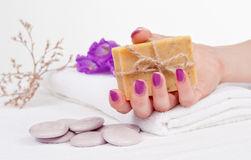 Purple Manicure And Herbal Soap Royalty Free Stock Photos