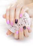 Purple manicure with a white ball of yarn Royalty Free Stock Images