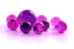 Purple Marbles. On a white surface Stock Images
