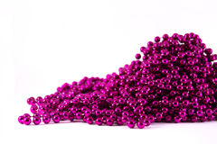 Purple mardi gras beads. A heap of purple mardi gras royalty free stock image
