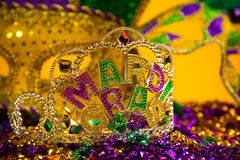 Purple Mardi-Gras or Venetian mask on purple background Royalty Free Stock Photos