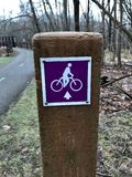 A PURPLE MARKER FOR A BIKE PATH ON A PUBLIC PATh. The Cleveland Metroparks has a fine set of paths and parks. Cleveland Metroparks is an extensive system of Royalty Free Stock Photography