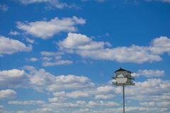 Purple Martin bird house with a blue sky background stock images