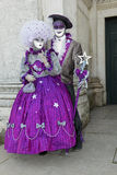 Purple Masked couple at Basilica Della Salute Royalty Free Stock Images