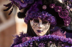 Purple masked woman portrait Royalty Free Stock Images
