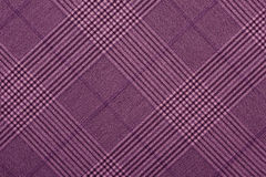 Purple material in geometric patterns, a background. Or texture Stock Images
