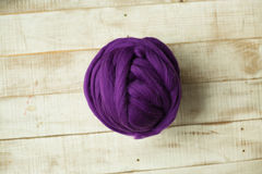 Purple merino wool ball Royalty Free Stock Image