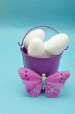 A purple metal bucket filled with white easter eggs Stock Photography
