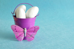 A purple metal bucket filled with white easter eggs Royalty Free Stock Photography