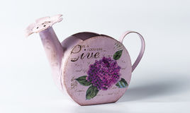 Purple metal watering can on white Royalty Free Stock Photo