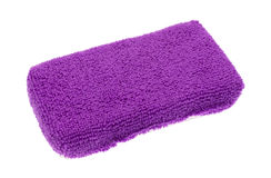 Purple microfiber sponge. A new purple microfiber kitchen sponge isolated on a white background stock photography