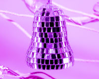 Purple mirrored bell ornament Stock Photos