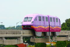 Purple monorail. A monorail is a rail-based transportation system based on a single rail, which acts as its sole support and its guideway. The term is also used Stock Photos