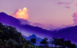 Purple morning fog in the mountains by Mica in Colombia. View on Purple morning fog in the mountains by Mica in Colombia Stock Photo