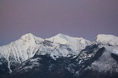 Purple Mountains with Alpine Glow and Snow Stock Photo