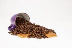 Purple mug with coffee beans 02. Purple mug with coffee beans royalty free stock photo