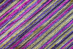 Purple multicolor background of a knitted textile material. Fabric with a striped texture closeup. Stock Photography