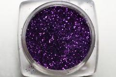 Purple nail makeup glitter Stock Images