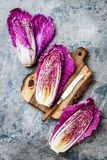 Purple napa cabbage over gray stone background. Plant based vegan or vegetarian cooking concept. Clean eating food. Alkaline diet stock photos