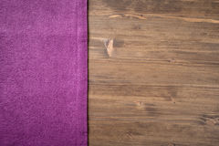 Purple  napkin from left side wooden table Stock Photos