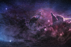 Purple nebula. And cosmic dust in star field Stock Photography