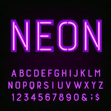 Purple neon light Alphabet Font. Royalty Free Stock Images
