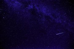 Purple night starry sky with shooting star royalty free stock photography