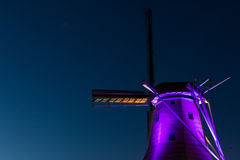 Purple Night Windmill Stock Images